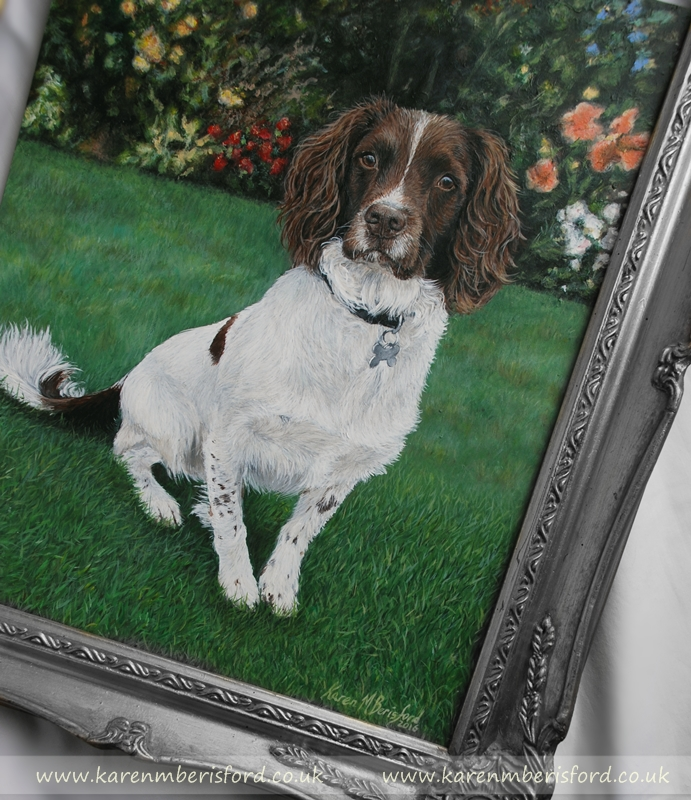 Liver Springer Spaniel Acrylic painting sat in a garden with brightly coloured flowers in a silver frame