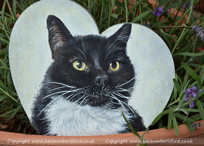 Black and white british shorthaired cat painted in acrylic paints on an MDF heart