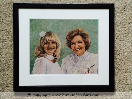 Framed portrait of a coloured pencil mother and daughter portrait
