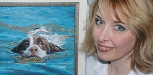 Karen M Berisford and an Acrylic painting of a Springer Spaniel swimming in bright blue water