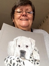 Happy customer holding her Coloured pencil portrait of her white Boxer boy, Cyrus