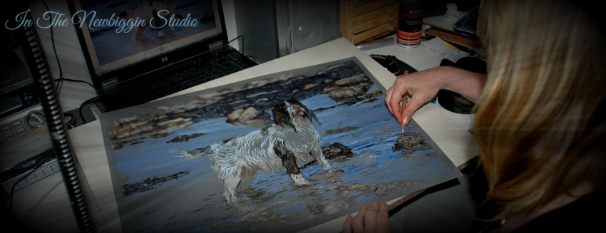 Karen M Berisford in her Newbiggin Art Studio working on a Springer Spaniel