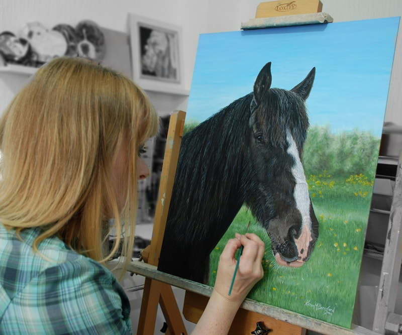 artist Karen in the studio painting a dark bay horse portrait
