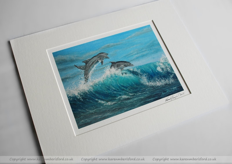 Giclee print of a trio of Dolphins created in Acrylic paints and mounted with an Ivory mount
