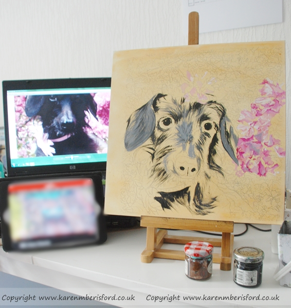 In the Art studio of an acrylics painting of a Black long haired Daschund