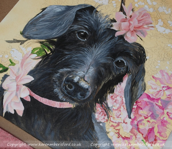 progress of an acrylic painting depicting a black long haired daschund wearing a pink flower neck bow and pink flower in her hair surrounded by cherry blossom