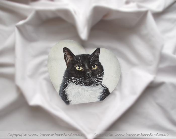 Black and white shorthaired cat acrylic painting on a heart shaped sheet of MDF