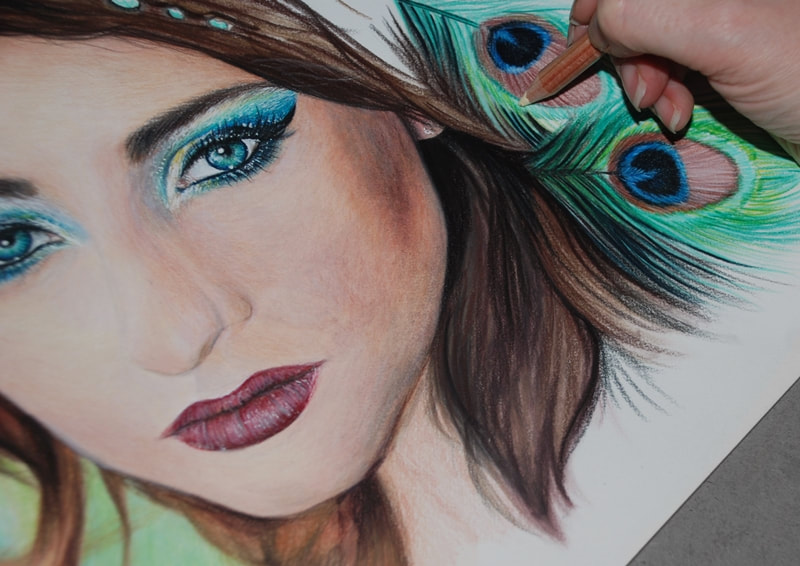 Female portrait being drawn in Coloured pencils