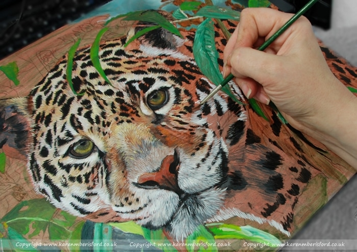 working on an acrylic painting of a Jaguar