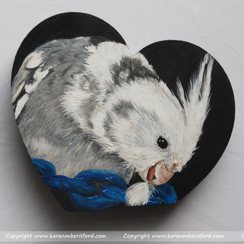 Pet painting of a white faced cockatiel in acrylic paints on an MDF shaped heart
