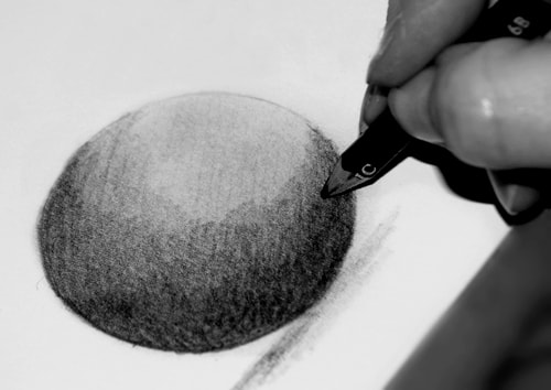 Drawing of a tonal ball using derwent graphic pencils