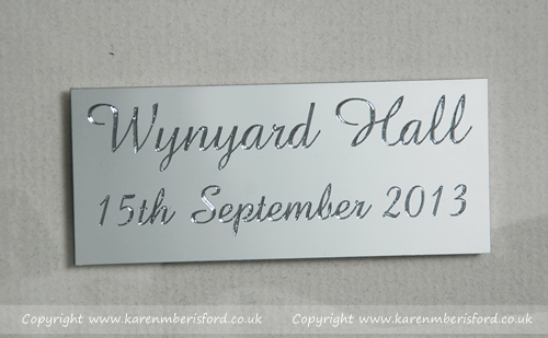A silver plaque attached to a Graphite portrait of Wynyard Hall for a wedding